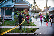 MILWAUKEE, WI -- 8/12/15 -- Residents try to get home past the police cordon at the scene at a non-fatal shooting in the 7th police district. The 7th district is among the most violent in the city. Milwaukee leads the nation in most negative indicators of African-American social problems: educational achievement gaps, incarceration rates, unemployment and segregation. This year Milwaukee has already seen more than double the number of homicides than all of 2014.…by André Chung #_AC13207