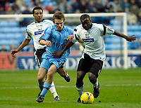 Photo: Ed Godden.<br />Coventry City v Derby County. Coca Cola Championship. 11/11/2006. Michael Johnson (R) keeps Coventry's Jay Tabb from the ball.