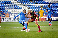 Peterborough United midfielder Siriki Dembele (10) and Bradford City forward Karl Henry (48) during  the The FA Cup 2nd round match between Peterborough United and Bradford City at London Road, Peterborough, England on 1 December 2018.