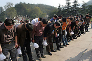 SHAOSHAN, CHINA - 4 NOVEMBER 2005 - A tour group prays in front of Mao's statue by bringing their hands together and kowtowing three times - a ritual that in ancient, feudal China was reserved for the emperor alone. Photo by Natalie Behring