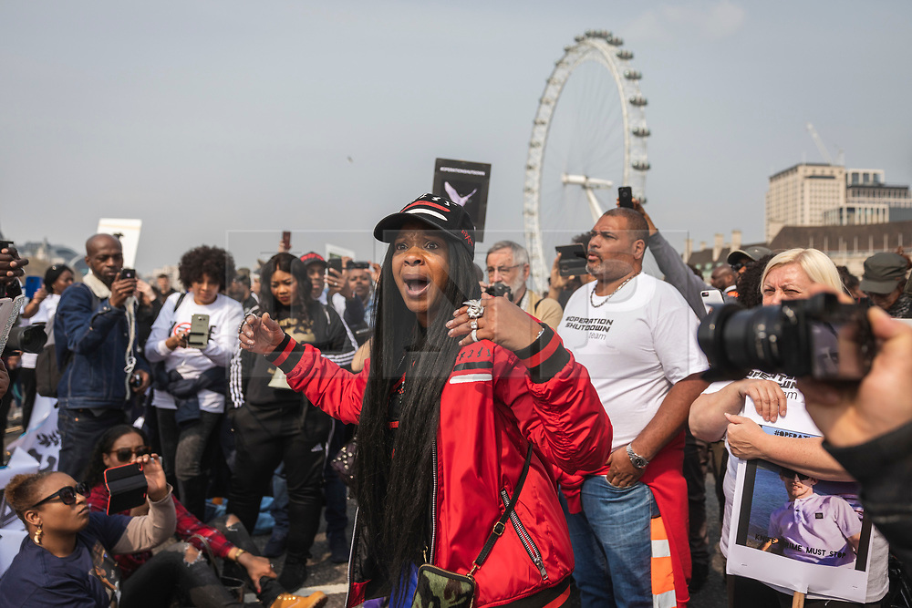 © Licensed to London News Pictures. 17/04/2019. London, UK. A woman speaks to bereaved relatives and campaigners as they hold a protest on Westminster Bridge to demand action on knife crime in the capital. Photo credit: Rob Pinney/LNP