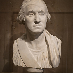 A bust of first American president George Washington inside the American Presidents' exhibit in the National Portrait Gallery of the Smithsonian Institution in the Chinatown neighborhood of Washington, DC.