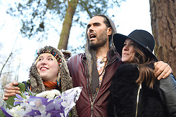 © Licensed to London News Pictures. 30/01/2016. Slough, UK. Russel Brand with Caroline Adams, 23 and Kathryn Camsey at the formal opening of a wooden treehouse in memory of murder victim Alice Adams in Black Park, Wexham on Saturday 30th January. The 20-year-old was stabbed to death in August 2011 with her friend and co-worker Tibor Vass, at a staff flat behind the Radisson Edwardian Hotel near Heathrow Airport. The murderer was Attila Ban, aged 32,  who also worked at the hotel as a receptionist. After the death of Alice, her family created a charity called, Alice Adams Foundation, to raise money to build the treehouse. Photo credit should read: Emma Sheppard/LNP