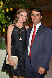 ROB ARCHIBALD and his fiancee FRANCESCA CUMANI at a dinner hosted by Cartier in celebration of The Chelsea Flower Show held at The Hurlingham Club, London on 19th May 2014.