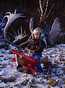 """Trapper Alsworth, fourth generation Alaskan """"bush pilot"""" in training, preparing to take-off from his front yard overlooking Lake Clark, Port Alsworth, Alaska."""