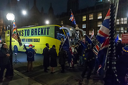 "Pro-Remain campaigners welcome a bus emblazoned with ""Bollox to Brexit"" as it arrives at Steve Bray's ongoing pro-remain protest at Old Palace Yard outside Parliament. Westminster, London, December 20 2018."