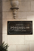 Close up of hotel entrance with scratched sign, Santiago, Chile