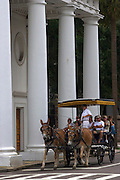 A horse carriage tour stops to view a church along historic Meeting Street in Charleston, SC. Charleston founded in 1670 is considered America's most beautifully preserved architectural and historic city.