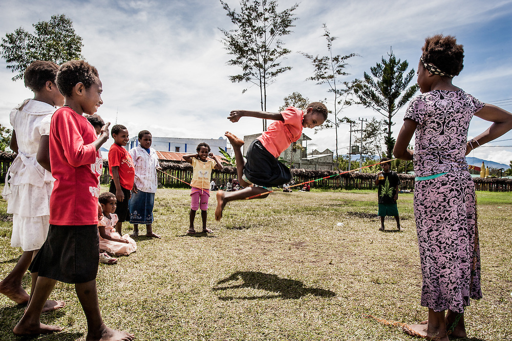 Children playing jump rope after Sunday School in the mountainous region of Papua<br /> <br /> HIV/AIDS is spreading at an alarming rate impacting the general population including children, men and women, husbands and wives, young and old, families and communities.