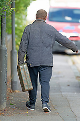 © Licensed to London News Pictures 27/09/2021.<br /> Swanley, UK, This man walked away with a large Jerry can full. Chaos at this Co-op petrol station in Swanley, Kent. This station had a delivery at 7.30 am this morning and at 2.30pm started to run out of diesel. Fuel panic buying continues today on forecourts up and down the UK as hoarders run petrol stations dry. Photo credit:Grant Falvey/LNP