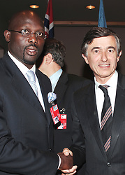 File photo : Liberian soccer star and former presidential candidate George Weah and French Foreign Affairs Minister Philippe Douste-Blazy attend the 'Fight Against AIDS International Drug Purchase Facility' press conference at the United Nations Headquarters in New York, on Friday, June 2, 2006. Former football star George Weah has been elected as Liberia's president. Mr Weah is well ahead of opponent Joseph Boakai with more than 60% of the vote. Photo by Nicolas Khayat/ABACAPRESS.COM