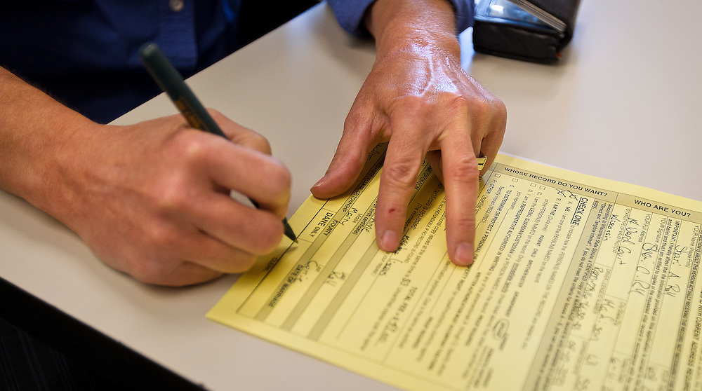 MADISON, WI - JUNE 11, 2014: Shari Roll fills out paperwork to receive her official certificate of marriage at the Dane County Register of Deeds. Roll and her wife Renee Currie were the first same sex couple to be legally wed in the state of Wisconsin on Friday, June 6, 2014.