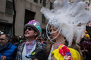 New York, NY, USA-27 March 2016. A woman sports an elaborate featherd hat in the annual Easter Bonnet Parade and Festival