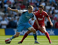 Photo: Jed Wee/Sportsbeat Images.<br /> Manchester City v Liverpool. The Barclays Premiership. 14/04/2007.<br /> <br /> Manchester City's Michael Johnson (L) shields the ball from Liverpool's Steve Finnan.