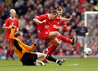 Photo. Jed Wee.<br /> Liverpool v Wolverhampton Wanderers, FA Barclaycard Premiership, Anfield, Liverpool. 20/03/2004.<br /> Liverpool's Michael Owen (R) hurdles over a tackle from Wolves' Mark Clyde.