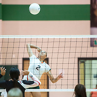 Sieyanne Platero spikes the ball for Wingate against Grants  Thursday night during their match in Fort Wingate.