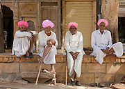 Local men sitting on a wall in Jaisalmer, Rajasthan, India