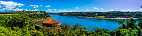 Panoramic view of the Triple Frontier of Brazil, Argentina and Paraguay. The Iguazu River is coming in from the left and meeting the Parana River. I am standing in Brazil. Looking across to the left is the marker in Argentina. And off to the right, on the farther side of the Parana, is Paraguay.