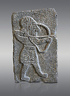 Hittite relief sculpted orthostat panel of an archer from the Palace of King Kapara, from Tell Halaf, ancient Guzana, Syria, iX cent BC, Louvre Museum. Cat No 11072. Grey background