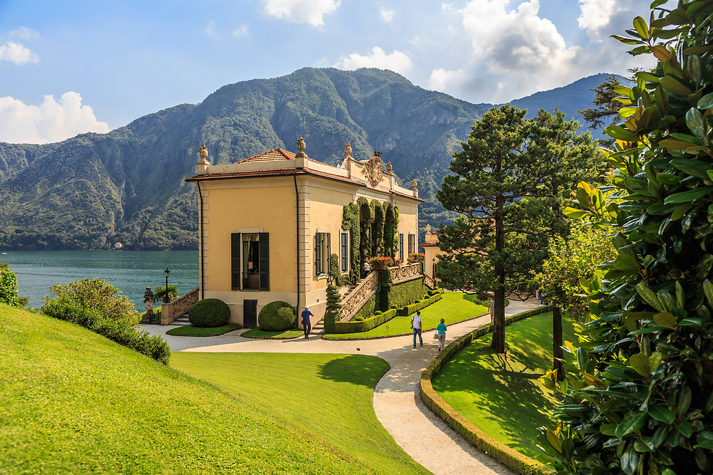 Villa Balbianello sits on the small peninsula of Dosso d'Avedo on Lago di Como, Italy. Its origin is a Franciscan monastery that existed on the tip of the peninsula since the 13th century. The two remaining towers are the campanile of the monastery's church. The last private owner, businessman and explorer Count Guido Monzino,  installed artifacts from his expeditions in the villa. In fear of the Red Brigade,  Monzino added a system of hidden passages, linking parts of the property.