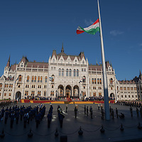 Honor guards raise the national flag before Hungarian Army officers take their oath of office during the national holiday celebrating the foundation of the Hungarian State in Budapest, Hungary  on Aug. 20, 2020. ATTILA VOLGYI