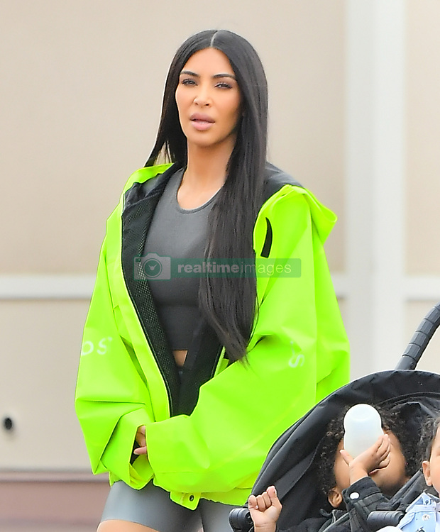 EXCLUSIVE: Kim & Kourtney Kardashian were spotted enjoying a day at Disneyland with their kids in Anaheim, CA. The famous sisters brought all of their kids including North West, Saint West, Penelope Disick, Mason Disick, and Reign Disick. Kim K was seen wearing a bright neon yellow jacket along with bike shorts from her husband's Yeezus clothing brand. The family was seen enjoying such as Thunder Mountain Railroad, Small World, Dumbo, and the carousel. 22 May 2018 Pictured: Kim Kardashian, Saint West, North West, Kourtney Kardashian, Mason Disick, Reign Disick, Penelope Disick. Photo credit: Snorlax / MEGA TheMegaAgency.com +1 888 505 6342