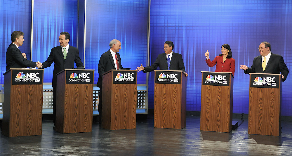 From the left, former U.S. Senate candidate Ned Lamont, former Stamford Mayor Dan Malloy, Ridgefield First Selectman Rudy Marconi, Former state legislator Juan Figueroa, Simsbury First Selectwoman Mary Glassman, and Waterbury Mayor Michael Jarjura, right, stand at podiums at the end of a Democratic gubernatorial debate in West Hartford, Conn., Friday, March 19, 2010. (AP Photo/Jessica Hill)