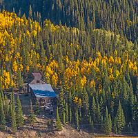 Fall colors light up old mine buildings near  Silverton, Colorado.