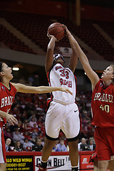 26 February 2009: Shala Jackson takes a jump shot with Kelly Krumweide in her face. The Braves of Bradley  and the Illinois State Redbirds battled it out on Doug Collins Court inside Redbird Arena on the campus of Illinois State University, Normal Il.