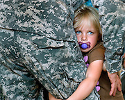 Kaitlyn Miller, 4, holds onto her uncle, PV2 Cody Caton, at the National Guard Armory in Harrisonburg on Monday. Caton and the rest of the Harrisonburg National Guard unit were visiting with family and friends before leaving for deployment in Iraq.