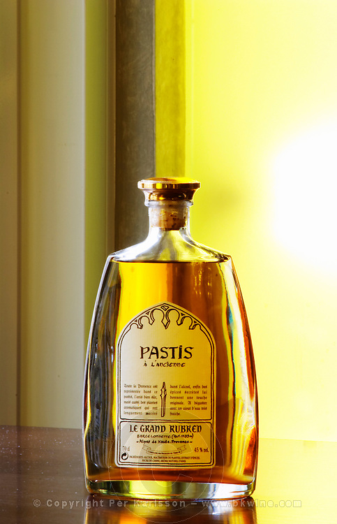 Pastis a l'ancienne, pastis as in olden times, Le Grand Rubren, Barcelonnette, Alpes de Haute-Provence Pastis is a spirit high alcohol drink flavoured flavored with herbs such as anise (badiane, anis étoilé etoile) and other spices. It is sometimes called pastis or Absinth absinthe. It is served in a tall glass with ice and you pour water on it. It gets cloudy milky when water is added. It is a favourite drink aperitif in Provence Southern France.