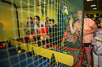 It was a frenzy of activity on Wednesday afternoon with folks seeking inside activities including the Alley Cat game at Funspot.  (Karen Bobotas/for the Laconia Daily Sun)
