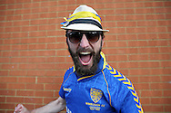 a AFC Wimbledon fan chanting outside The Cherry Red Records Fans' Stadium before k/o. Skybet football league two play off semi final, 1st leg match, AFC Wimbledon v Accrington Stanley at the Cherry Red Records Stadium in Kingston upon Thames, Surrey on Saturday 14th May 2016.<br /> pic by John Patrick Fletcher, Andrew Orchard sports photography.