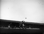 07/09/1960<br /> 09/07/1960<br /> 07 September 1960<br /> Soccer: City Cup Final, Drumcondra v Cork Celtic at Tolka Park, Dublin. Cork goalie, Brohan, punches the ball clear while pressured by McCaffery (Drumcondra).