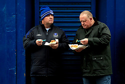 Everton fans grab a bite to eat outside Goodison Park before the game