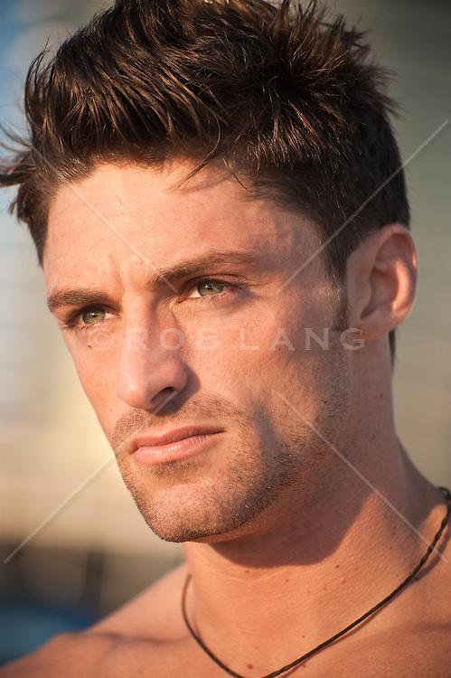 Headshot of man with facial scruff