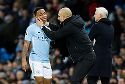 Manchester City's Raheem Sterling with manager Pep Guardiola during the Premier League match at The Etihad Stadium, Manchester.