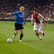 NLD/Amsterdam/20060823 - Ajax - FC Kopenhagen, duel Klaas Jan Huntelaar en Lars Jacobsen