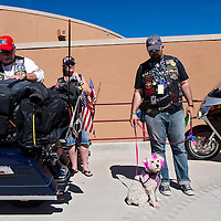 051613       Cable Hoover<br /> <br /> Veteran and ride participant Louis Montalvo, right, stands with his dog Lacey at for the reception of Run for the Wall veteran's memorial motorcycle ride Thursday at Red Rock Park in Gallup.