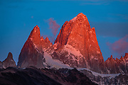 "Sunrise illuminates Cerro Fitz Roy (3405 meters or 11,171 feet elevation), as seen from Mirador al Chaltén on Ruta 23 just 2 km southeast of the village of El Chalten in Santa Cruz Province, Argentina, Patagonia, South America. Monte Fitz Roy is also known as Cerro Chaltén, Cerro Fitz Roy, or Mount Fitz Roy. The first Europeans recorded as seeing Mount Fitz Roy were the Spanish explorer Antonio de Viedma and his companions, who in 1783 reached the shores of Viedma Lake. In 1877, Argentine explorer Francisco Moreno saw the mountain and named it Fitz Roy in honour of Robert FitzRoy who, as captain of HMS Beagle, had travelled up the Santa Cruz River in 1834 and charted large parts of the Patagonian coast. Mt Fitz Roy was first climbed in 1952. Cerro is a Spanish word meaning hill, while Chaltén comes from a Tehuelche word meaning ""smoking mountain"", due to clouds that usually form around the peak."