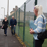 Kelly McDonald, a YES campaigner, greets new voters.<br /> <br /> Scottish referendum in Edinburgh. All through out the day a huge number of voters turned out asll over Scotland to vote in the independence referendum. The polls were open from 7am till 10pm and the count went on through-out the night with the final results announced early in the following morning.