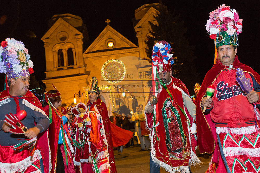 Catholic faithful dressed as Matachin warriors lead a procession from the Cathedral Basilica of St. Francis of Assisi celebrating our Lady of Guadalupe December 11, 2015 in Santa Fe, New Mexico. Guadalupanos as the devotees are known, celebrate the apparitions of the Virgin Mary to an Aztec peasant at Tepeyac, Mexico in 1531.
