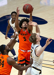 Feb 25, 2021; Berkeley, California, USA; Oregon State Beavers guard Ethan Thompson (5) steals the ball from California Golden Bears center Lars Thiemann (21) during the first half of an NCAA college basketball game at Haas Pavilion. Mandatory Credit: D. Ross Cameron-USA TODAY Sports