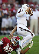 TUSCALOOSA, AL - NOVEMBER 10:  Linebacker Adrien Hubbard #42 of the Alabama Crimson Tide attempts to tackle quarterback Johnny Manziel #2 of the Texas A&M Aggies during the game at Bryant-Denny Stadium on November 10, 2012 in Tuscaloosa, Alabama.  (Photo by Mike Zarrilli/Getty Images)