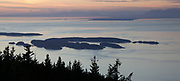 Mount Constitution is a mountain on Orcas Island, and the highest point in the San Juan Islands. A stone observation tower patterned after a medieval watch tower stands at the summit. It was built by the Civilian Conservation Corps in 1936. The tower offers panoramic views of the surrounding islands, the Cascade Mountains, and many Canadian and American cities. On a clear day, the view encompasses locations as diverse as Mount Baker, Mount Rainier, Saturna Island, and the cities of Vancouver, and Victoria, British Columbia. Mount Constitution lies within the 5,000 acres (20.2 km2) Moran State Park.