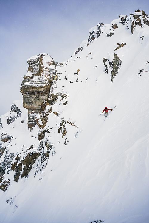 Sebastien Trudeau drops into the Elevator Shaft chute, Meadow Hut, Esplanade Range, BC.