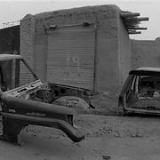 The skeletons of stripped vehicles sit in a laneway behind mudwalled buildings in the city of Wesh, Spin Boldak District, Kandahar, Afghanistan. Anything and everything has value in Afghanistan and is sold, traded, reused and or transformed into something of use.(Credit Image: © Louie Palu/ZUMA Press/The Alexia Foundation).....