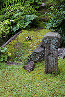 """Tome Ishi is a stone is wrapped in rope and placed in a path or in front of a gate. They're sometimes called """"stop stones"""" sekimori-ishi indicating that entry is forbidden. They are commonly found at temples,  tea houses or traditional Japanese gardens."""