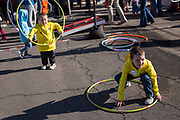 Brothers Colton, right, and Camden Alford play with hula hoops at the AARP Block Party at the Albuquerque International Balloon Fiesta in Albuquerque New Mexico USA on Oct. 8th, 2018.