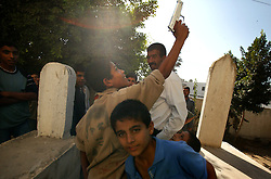 Palestinians visit the graves of Anam and Abdul Rahman Al Qedua, Yasser Arafat's sister and father respectively, Khan Yunis, Palestinian Territories, Nov. 9, 2004. Arafat was diagnosed with liver failure while in critical condition in a Paris hospital.